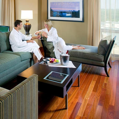 man and woman in robes sitting on couches in the guest suite