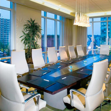 large conference table with white chairs