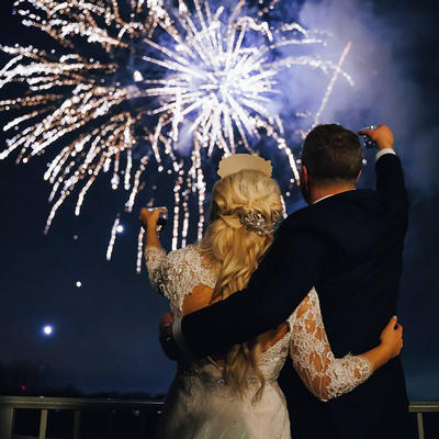 bride and groom toasting a NYE Fireworks Display