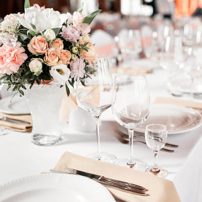 wedding reception setup with pink flower centerpieces
