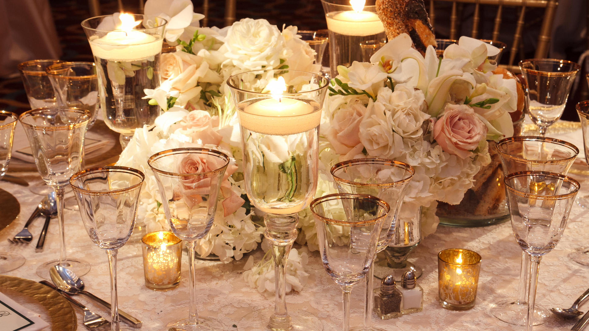 elegant wedding table with large flower centerpiece