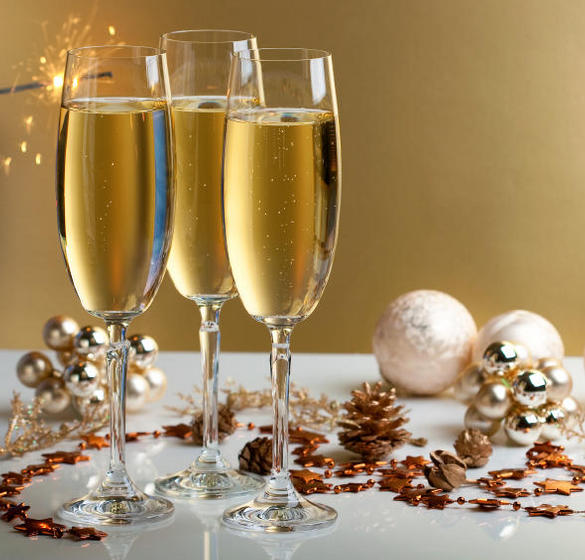 Champagne glasses and holiday decor